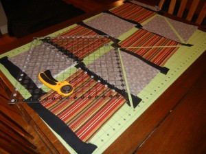 Make 'banners' with alternative fabrics.  The squares are sewn together with wavy black strips in between.