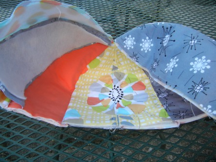 At this point, the inner petals are nested against the outer petals and some petals have been basted.